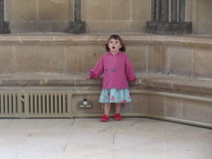 Polly, aged 2 and in architectural awe at Wells Cathedral